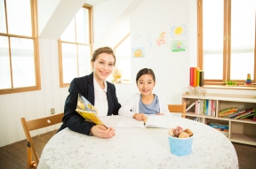 Young Student Learning English With A Foreign Female Teacher